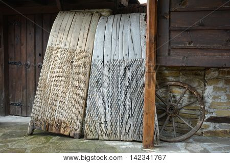 A threshing board is an obsolete farm implement used to separate cereals from their straw poster
