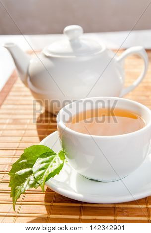 Tea. Mint Tea. Herbal tea. Mint leaf. Mint leaves. Tea in a glass cup mint leaves dried tea sliced lime. herbs tea and mint leaves on a slate plate in a restaurant or teahouse tea room.