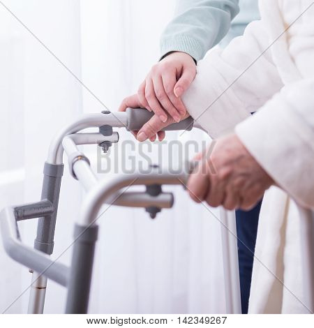 Carer Assisting Disabled Patient