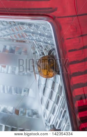 rear car tail light close up fragment with lamp