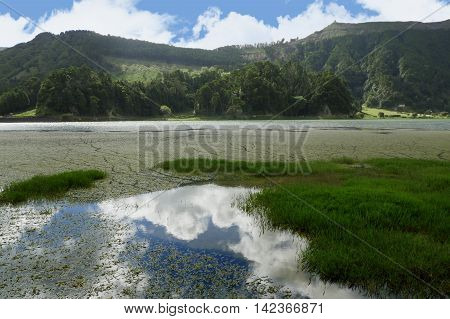 amazing beautiful scenic landscape view of Green Lake or Lagoa Verde in Sete Cidades of Sao Miguel island of Azores in Portugal in holiday tourism and vacation travel destinations concept