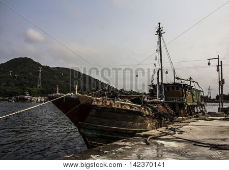 Lingshui, fishermen floating village, Nanwan Monkey Island and transoceanic ropeway as background,