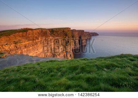 Cliffs of Moher - Irish national landmark at sunset