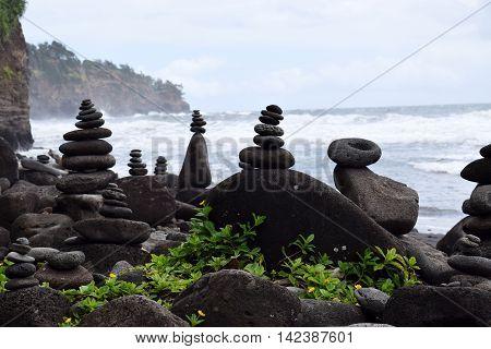 rock stacks balancing on the Polulu black sand beach, Kohala coast, Big Island, Hawaii