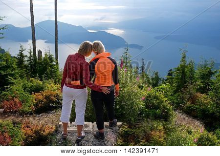 Mother and daughter hugging outdoor. Bowen Lookout in Cypress Mountain Provincial Park North Vancouver British Columbia Canada.