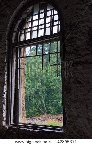 The Old Large Window Without Glass, With A Broken Wooden Frame, With Views Of The Forest