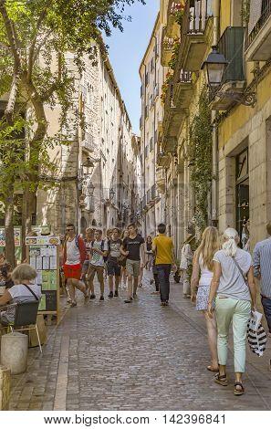 GIRONA SPAIN - JULY 6 2016: Ancient street in Girona Catalonia Spain