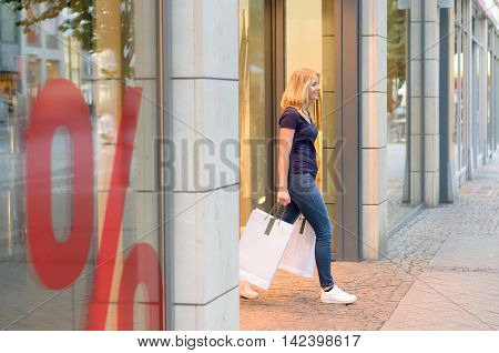 Young Blond Woman Out Shopping In Town