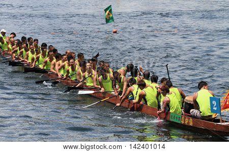 HONG KONG - MAY 25, 2014: Unidentified team competes at the 2014 Dragon Boat Race to celebrate the Tuen Ng festival at Chai Wan bay on May 25, 2014 in Hong Kong.
