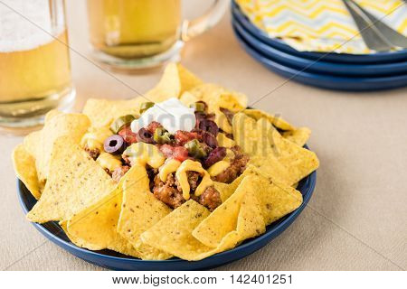 Nachos With Beef, Jalapeno Peppers, Olives, Tomato, Beans, Cheese And Sour Cream