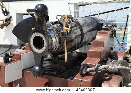PORTSMOUTH, UK - JUNE 12, 2014: Historic cannon on Portsmouth warship on June 12, 2014 in Portsmouth, UK. Historical warships of the UK royal navy are displayed in the Portsmouth landmark dockyard.