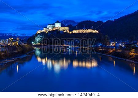 Castle Kufstein reflecting in Inn river in Austria - architecture and travel background