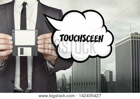 Touchsceen text on speech bubble with businessman holding diskette