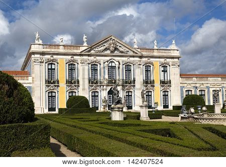 QUELUZ, PORTUGAL - October 26, 2015: The National Palace of Queluz seen from the gardens on October 26, 2015 in Queluz, Portugal