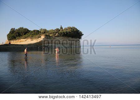 CORFU, GREECE - JULY, 23, 2016: Young people at Sidari beach
