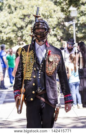 CAGLIARI, ITALY - May 29, 2016: Sunday at La Grande Jatte VIII Ed. At the Public Gardens - Sardinia - portrait of a man in a steampunk costumes