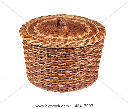 basket brown-yellow made using newspaper tubes isolated on white background