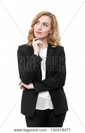 Pensive woman wearing black suit and white collarless shirt looking to one side. Concept of decision making in business