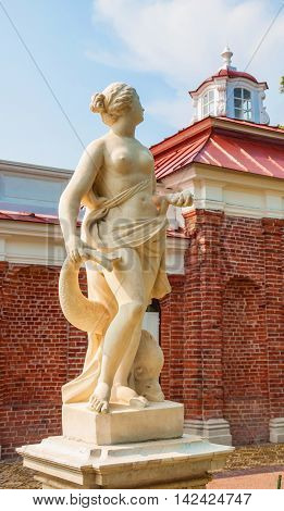 ancient marble sculpture of goddess of love, venus (aphrodite) located on terrace of palace monplaisir in peterhof. author unknown. russia, st. petersburg, peterhof. july 26, 2016