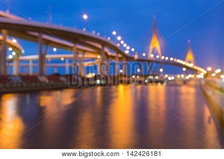 Twilight, blurred bokeh lights highway and suspension bridge, abstract background