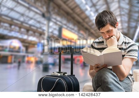 Delayed Train Concept. Man Is Sitting In Train Station And Readi