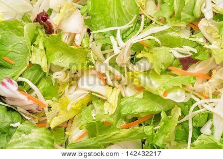 Vegetable salad mix closeup texture detail background