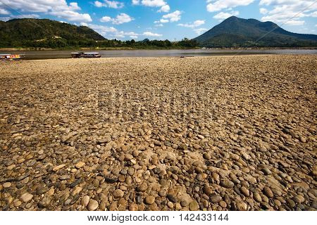 Riverside have brown rocks at Mekong river in sunny day