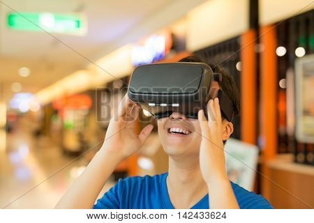 man wear virtual reality headset happily asian