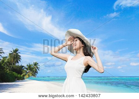 young woman wear dress and smile with beach and sea