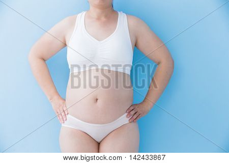 Fat overweight woman body with blue background asian