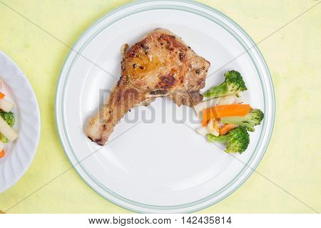 Chef decorated pork chop steak / cooking porkchop steak concept