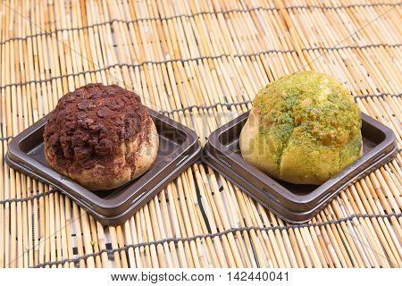 Chocolate and green tea choux cream on the tray
