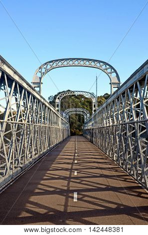 Walkway over an arched bridge that spans the Woronora River, Sutherland Shire, New South Wales, Australia