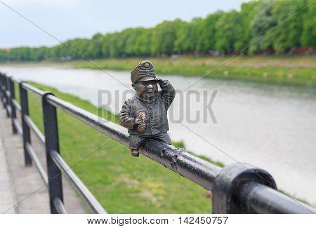 Uzhgorod Ukraine - : Small bronze statue of Good Soldier Svejk attached to the handrails at Kyivska embankment of the river Uzh