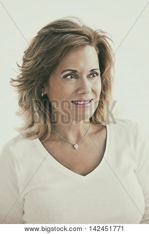 Portrait of a Beautiful Mature Woman wearing White Top