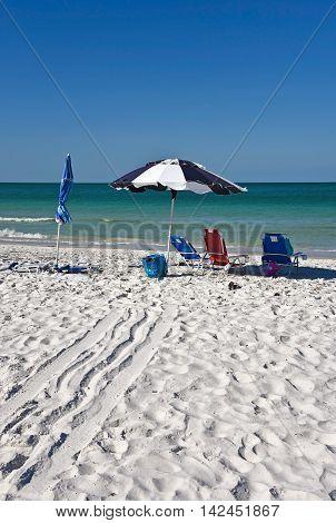 Beach Umbrella and Three Chairs on the Beach of Anna Maria Island