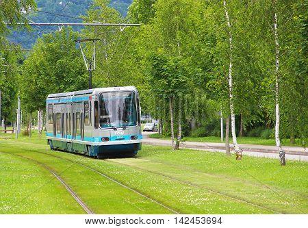 GRENOBLE, FRANCE - JUNE 18, 2016: Modern tram on the street of Grenoble