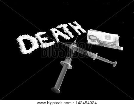Cocaine drug powder in shaped death word, two crossed injections and hundred euro banknote on black background in black and white colors