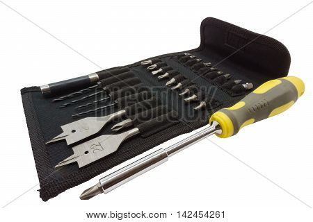 Screwdriver with interchangeable nozzles and a set of tools isolated on white background