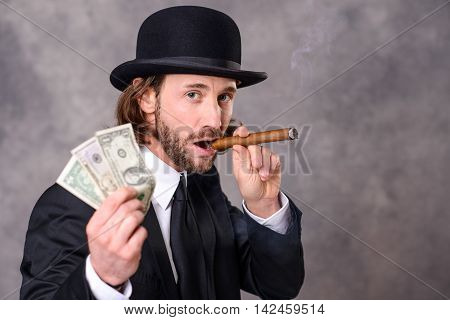 Businessman With Bowler Hat And Big Cigar And Money