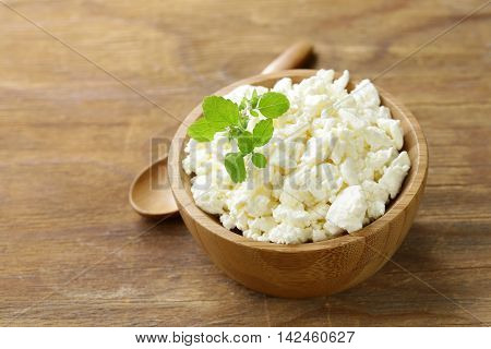 homemade organic cottage cheese in a wooden bowl