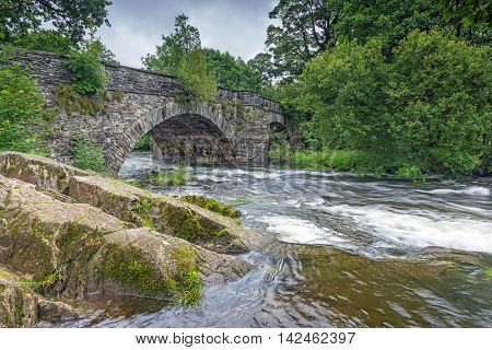 The River Brathay flows under Skelwith Bridge near Ambleside in the Lake District National Park, Cumbria, England a popular area for tourists.