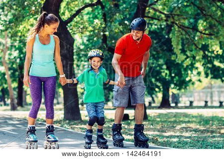 Family With One Child Roller Skating