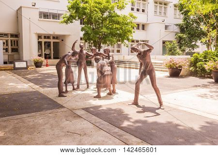 Bangkok, Thailand - June 5, 2016 : Statue of student or scholar or collegian at the Faculty of Art, Chulalongkorn University