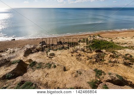 Sandstone low cliffs beach and sea Taddiford Gap Milford on Sea Hampshire England United Kingdom.