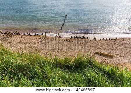 Pebble beach with worn defences. Lepe Country Park Exbury Southampton Hampshire England United Kingdom