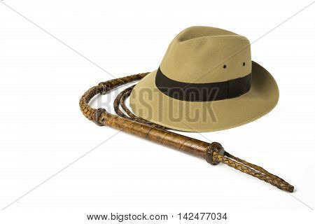 Adventure concept. Fedora hat and bullwhip isolated on white background.