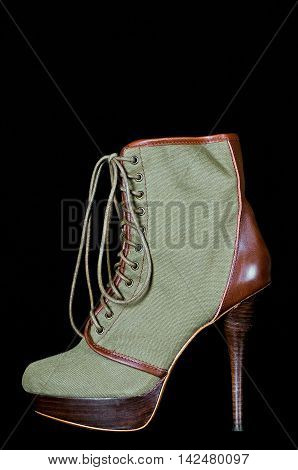 Fashionable High Heel Lace Up Boots for Women isolated on Black Background