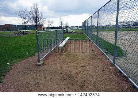 A dugout next to a baseball field in Joliet, Illinois.