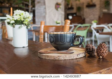 hot fresh coffee in white cup on wooden table spoon saucer white cream daisy flower in coffee shop cappuccino coffee mocha coffee espresso coffee latte coffee
